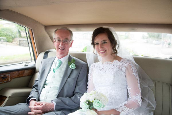 bride and father in the back of the wedding car barnsley wedding