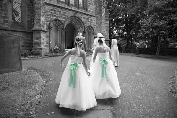 bridal party walking up the path to christ church ardsley barnsley