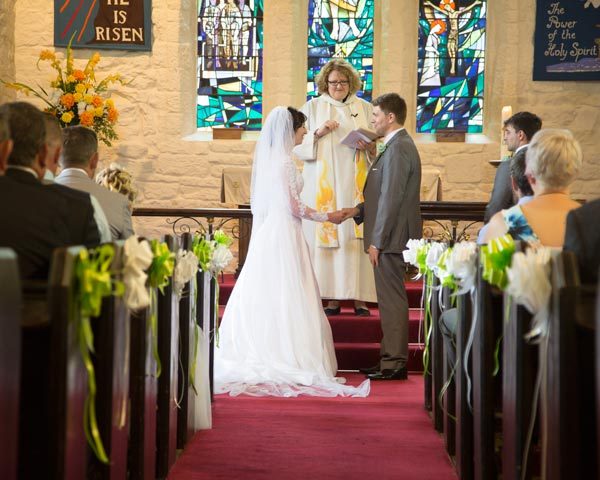 bride and groom holding hands during the wedding ceremony christ church ardsley barnsley