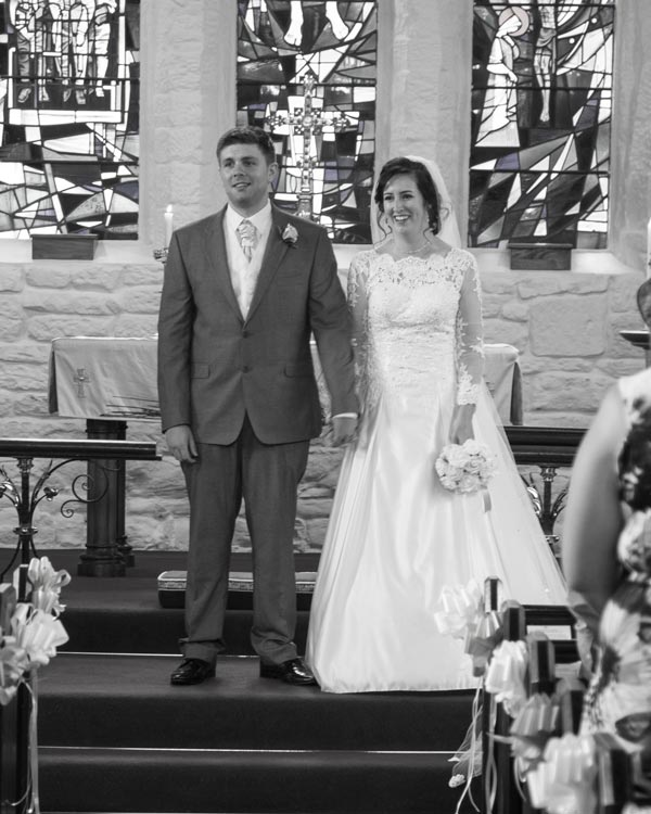 newlyweds facing their uests during the wedding service christ church ardsley barnsley