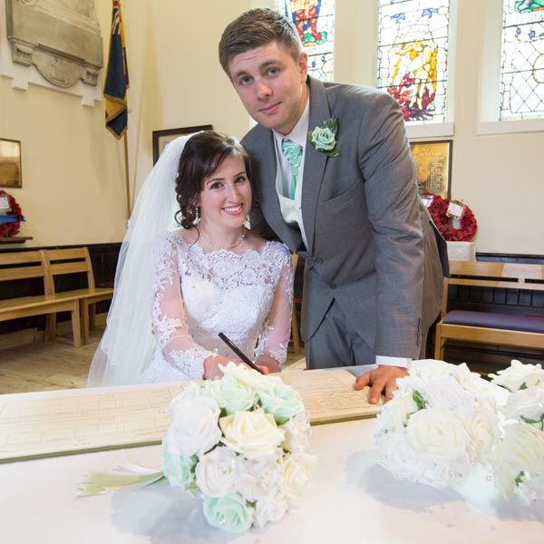 couple signing the register christ church ardsley barnsley