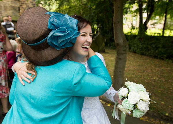 bride hugging guests christ church ardsley barnsley