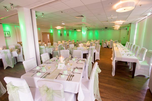 th rigby suite barnsley set up for a wedding with coloured lighting