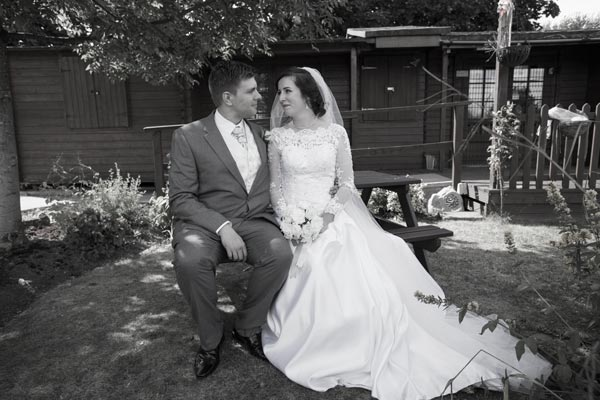 couple in front of shed sitting on bench carers garden metrodome barnsley