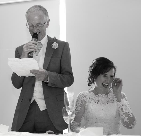 father of the bride giving speech with daughter crying with laughter rigby suite wedding barnsley premier leisure