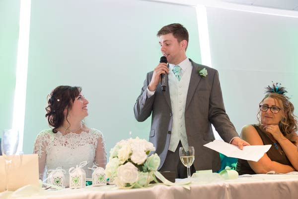 groom giving speech with new wife and mother rigby suite wedding barnsley premier leisure