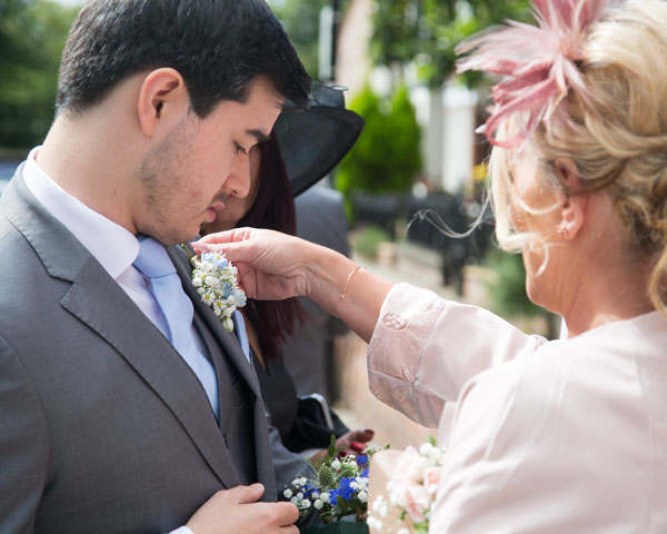 mother of the bride fixing grooms buttonhole