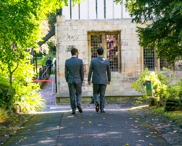 groomsmen walking to the hospitium york