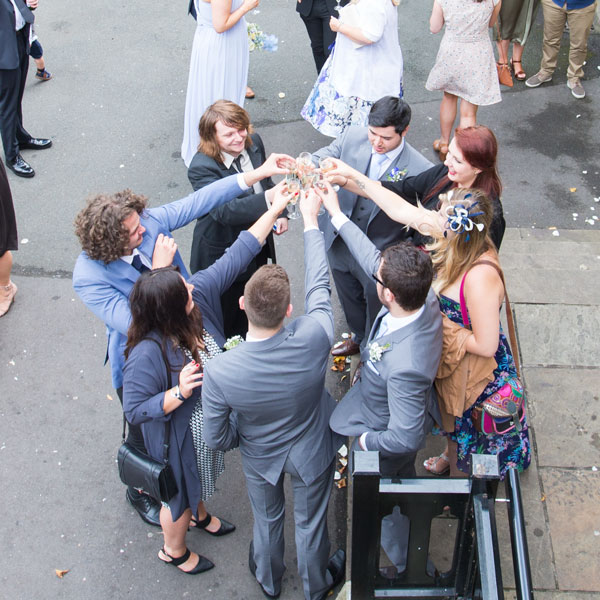 guests making a toast in a circle barnsley photography