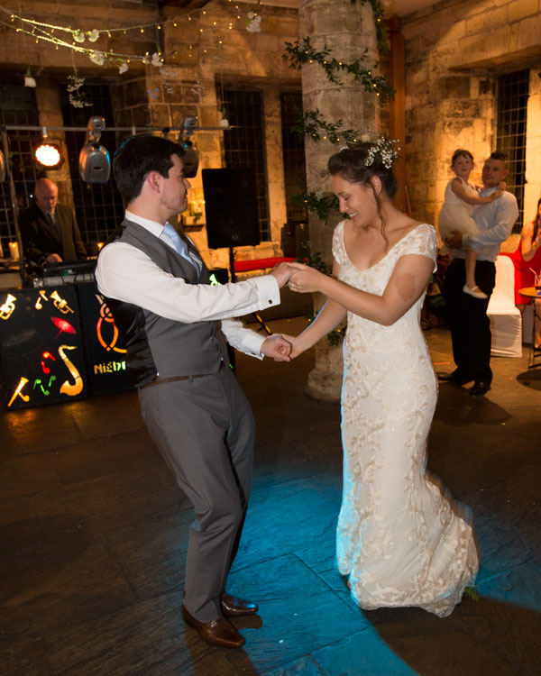 newlyweds on dancefloor in york hospitium