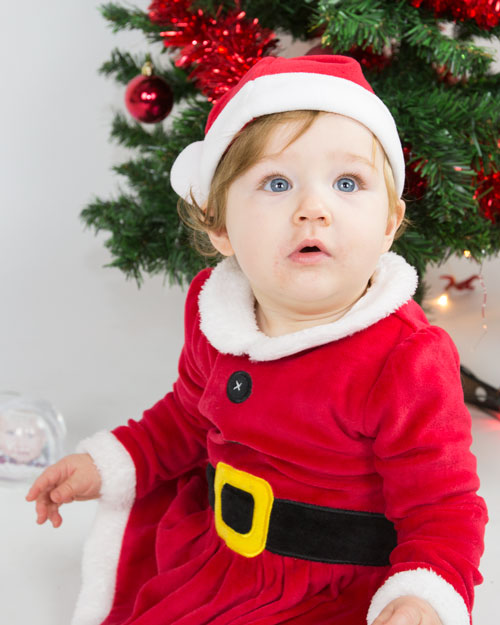 baby sitting in santa dress christmas studio shoot barnsley