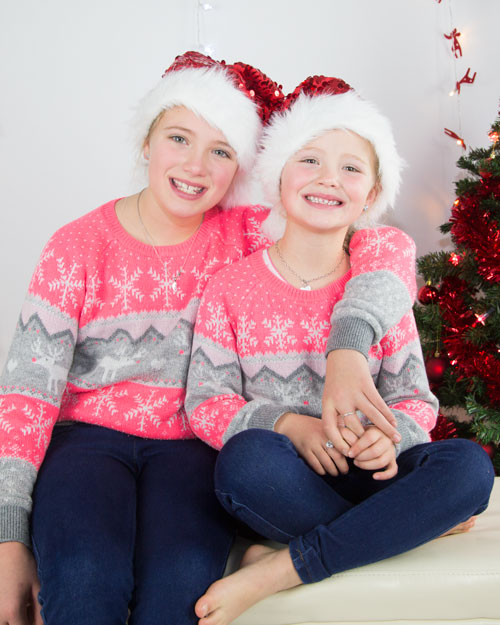 sisters in matching jumpers and christmas hats photo shoot barnsley