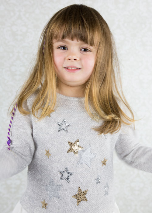 girl in star jumper against fancy background free photo shoots barnsley