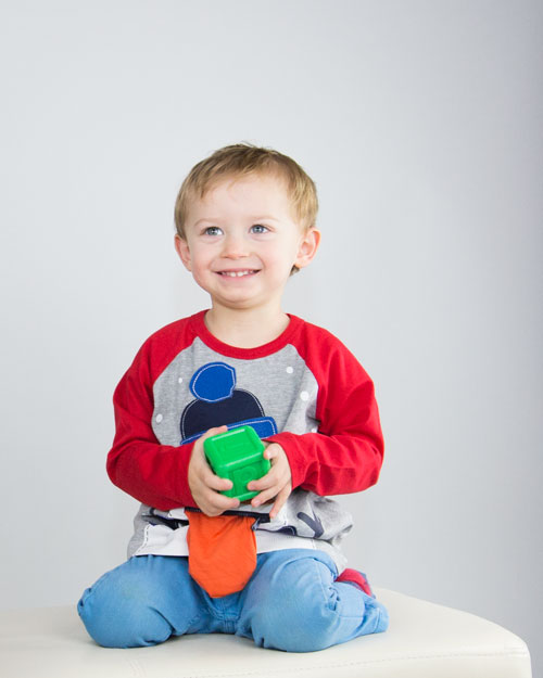 barnsley family photographer boy sitting on chair holding building blocks