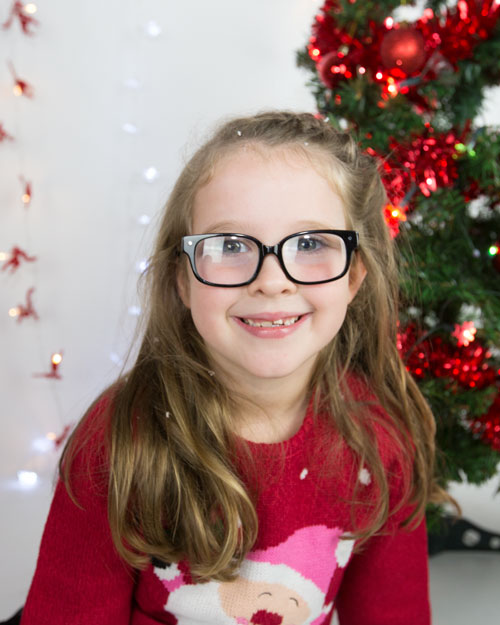 girl in glasses with fake snow in her hair family photo shoot barnsley