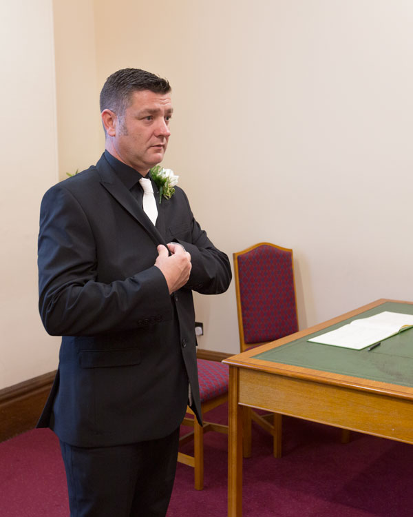 Groom waiting for bridal party inside sheffield town hall wedding