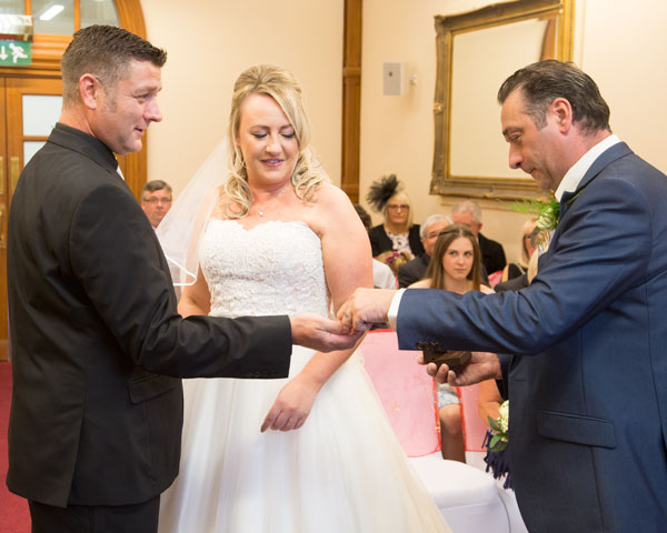 best man holding the rings during the wedding ceremony sheffield town hall south yorkshire