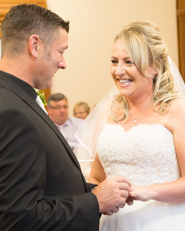 bride smiling during exchange of the rings sheffield wedding photographer