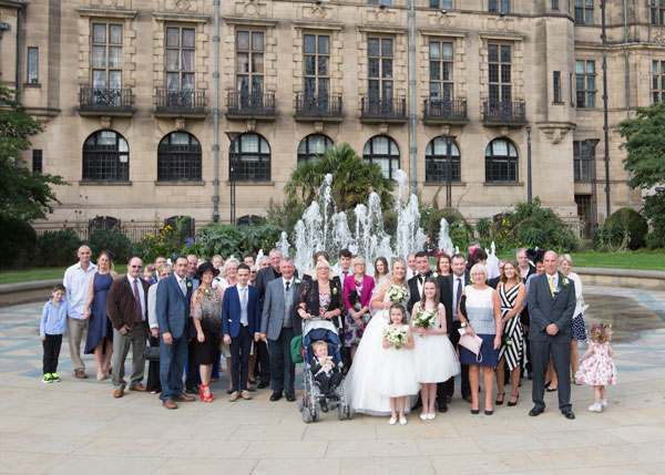 wedding party in peace gradens sheffield with sheffield town hall in background barnsley photographer