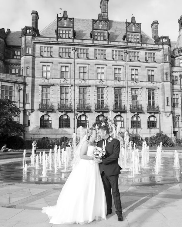 newlyweds in front of the fountains and sheffield town hall wedding photography south yorkshire