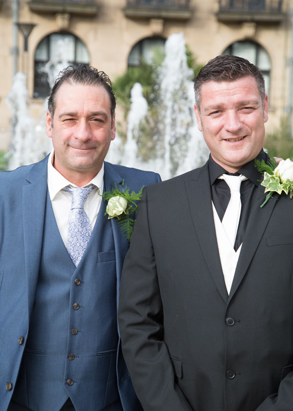 groom and best man outside sheffield town hall in the peace gardens wedding photography south yorkshire