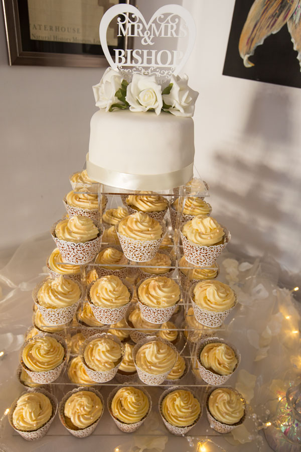 white wedding cake with golden cupcake tiers white bear penistone sheffield wedding photographer