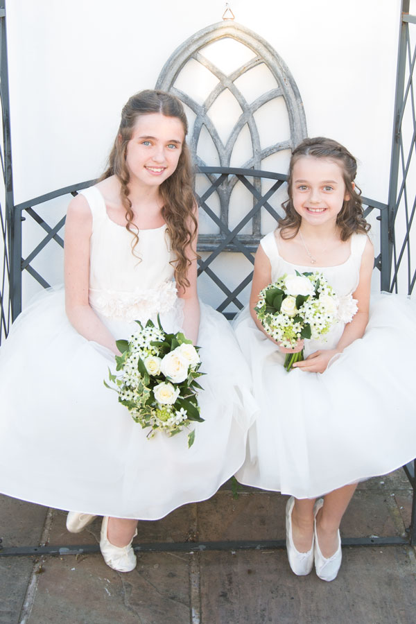Bridesmaids with white bouquets in white dresses and satin shoes sitting on bench the white bear penistone sheffield