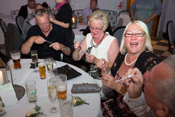wedding guests playing with bubbles during evening reception the white bear penistone wedding photography south yorkshire