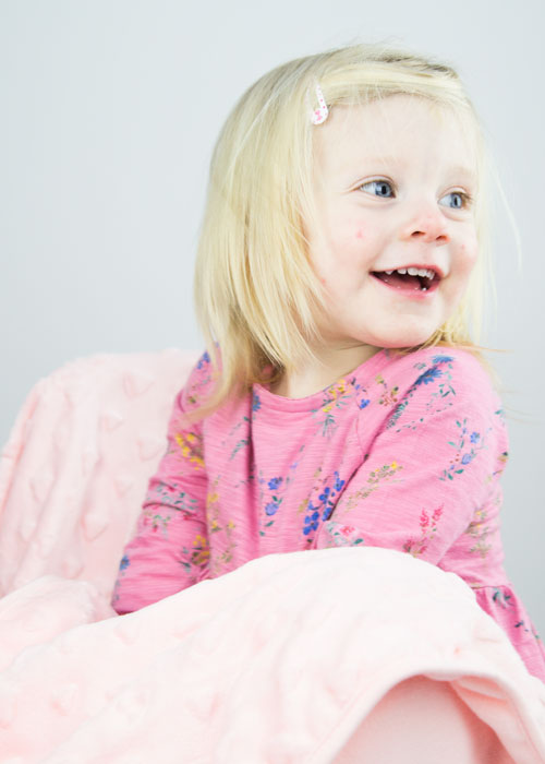 blonde girl in pink dress sitting with pink blanket barnsley studio photographer