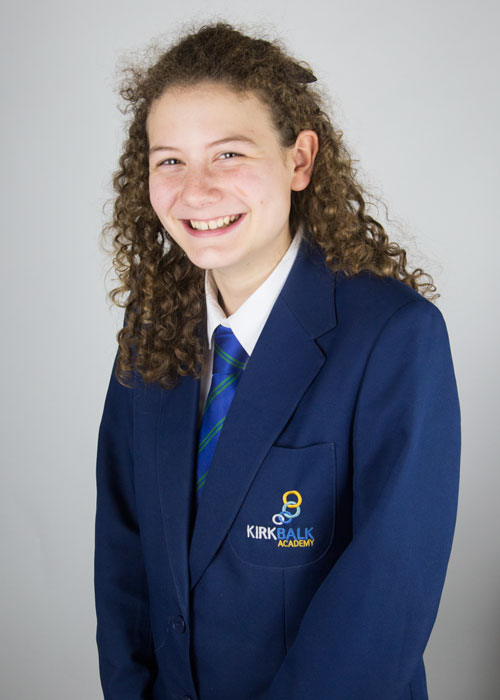 school uniform photography barnsley girl with curly hair in Kirk balk uniform