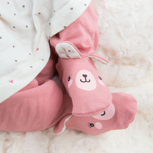 babies feet in pink teddy tights barnsley newborn photography