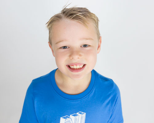 boy with blonde hair in blue tshirt looking upwards barnsley photographer
