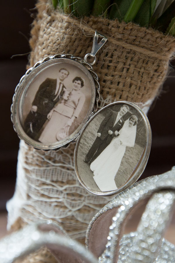 locket on the bottom of the bouquet with grandparents wedding day inside
