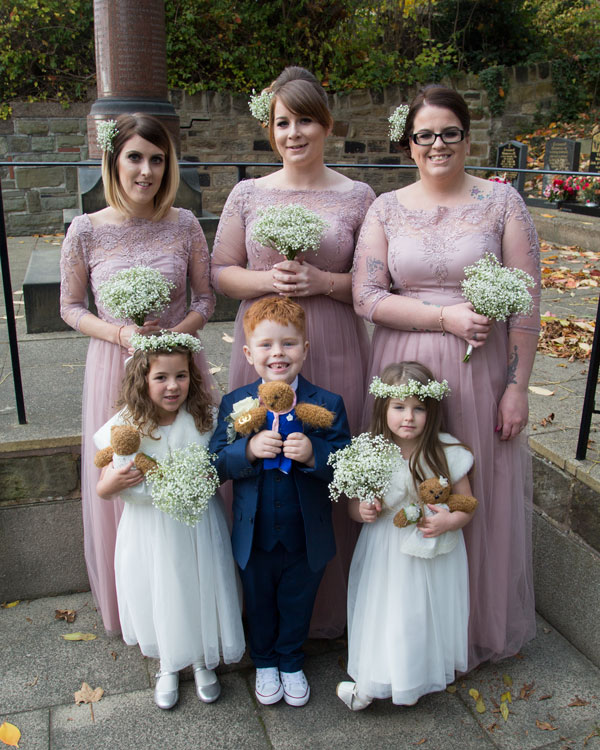 bridesmaids waiting for bride to arrive at church st thomas church worsbrough