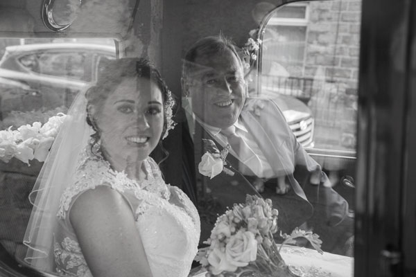 Bride with Father of the bride in wedding car black and white reflection Barnsley photographer