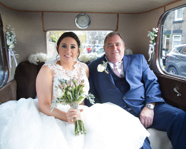 Bride with father of the bride inside wedding car barnsley photographer