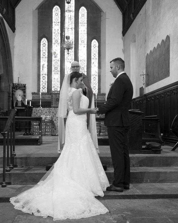 bride and groom exchanging rings st thomas church worsbrough dale barnsley photographer