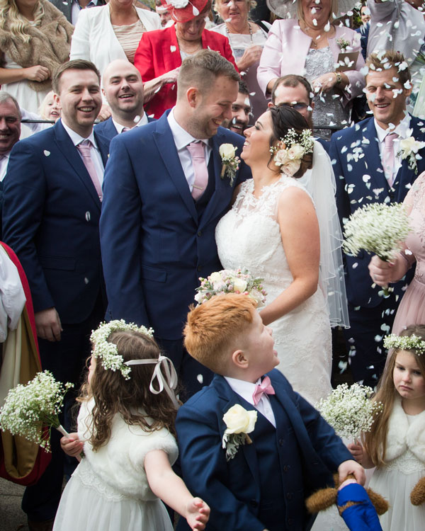 wedding party throwing confetti onto bride and groom barnsley photographer