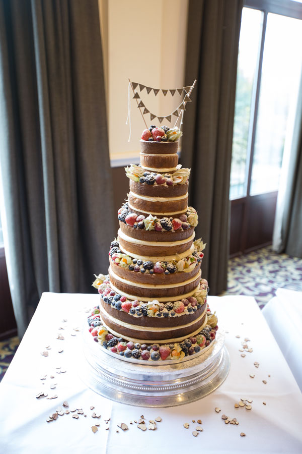 naked wedding cake with berries and just married bunting cake topper holiday inn barnsley photographer