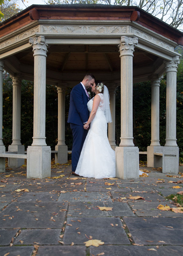 Couple under stone archway in secret garden holiday inn bransley photographer