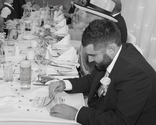 best man checking cue cards for best mans speech black and white holiday inn barnsley photographer