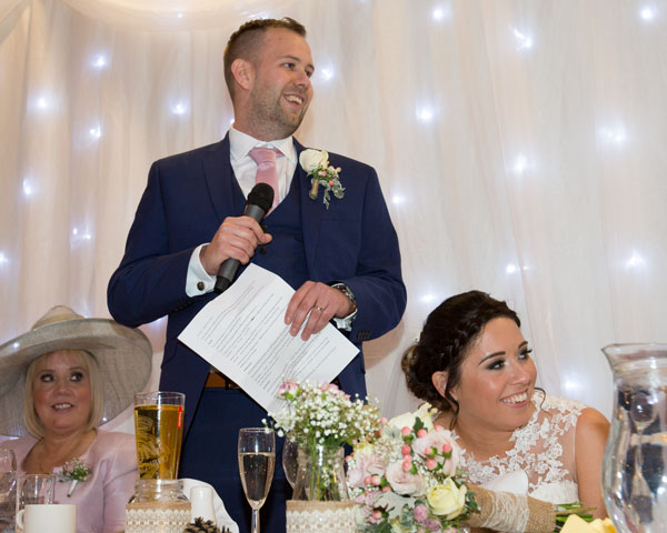 bride laughing during grooms speech bonfire night wedding