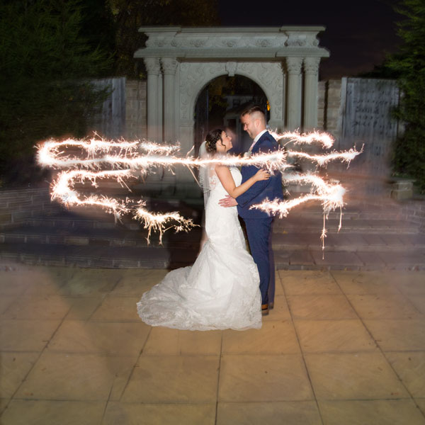 bride and groom with sparkler photograph holiday inn barnsley photographer