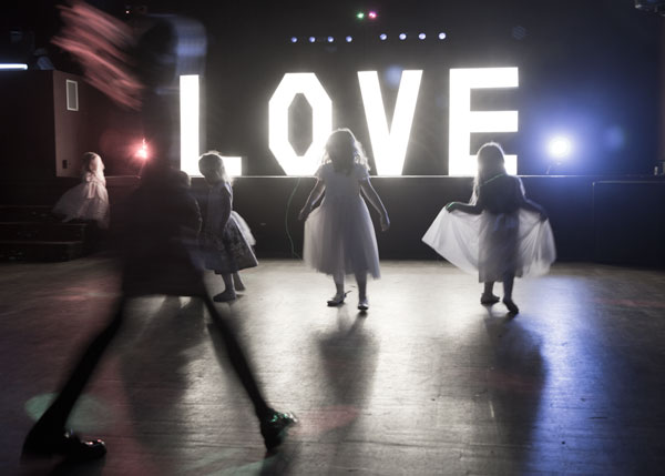 Children dancing with love light up letters on stage holiday inn barnsley photographer