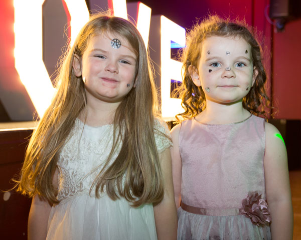 two girls on the dancefloor with glittery faces holiday inn barnsley photographer