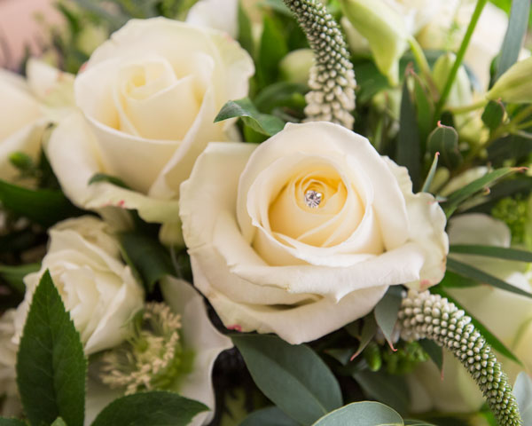 White rose with diamante centre in the bridal bouquet