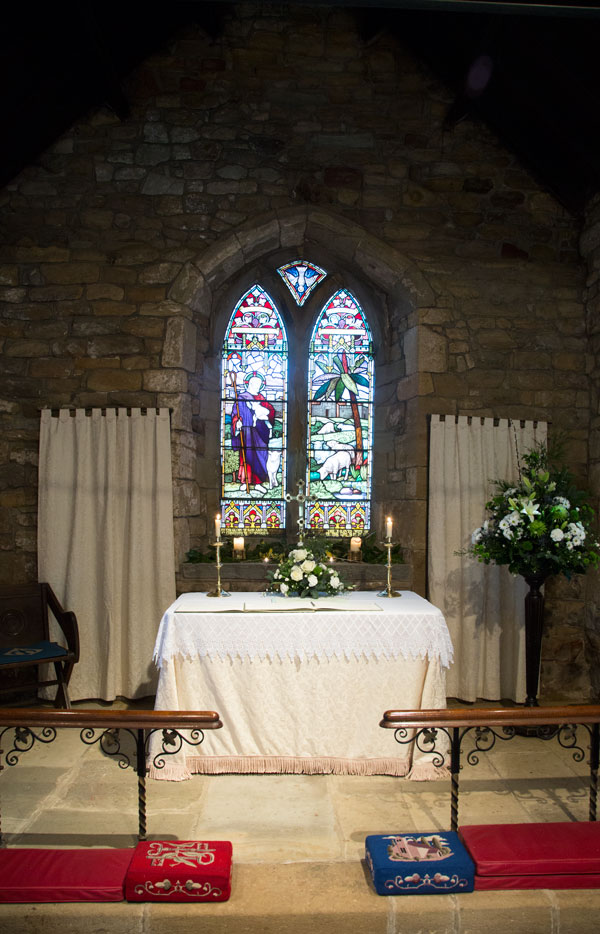 The altar and stained glass window at St John the Baptist church Adwick upon Dearne wedding photographer