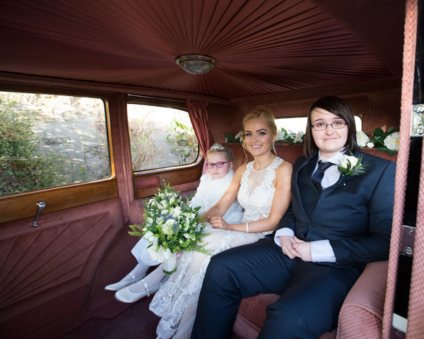The three bridesmaids inside the wedding car arriving at the church ceremony Adwick Wedding Photographer