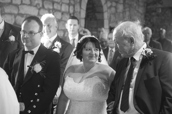 Bride looking at Father of the bride at the altar black and white photography