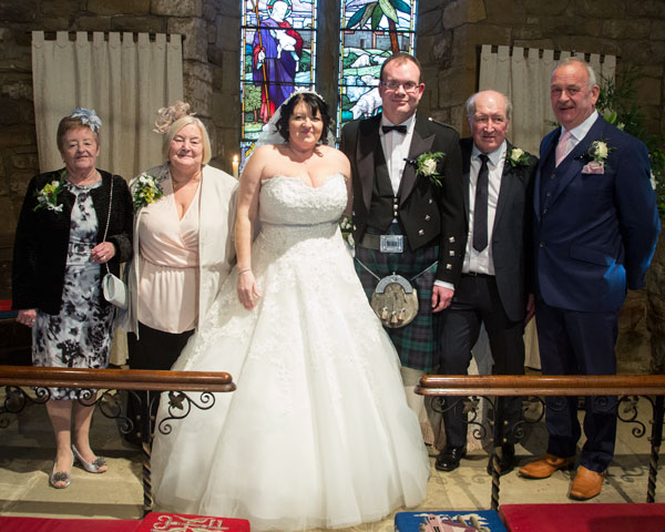 Bride Groom and both sets of parents at the altar in St John the Baptist church Adwick Upon Dearne Adwick Wedding Photographer